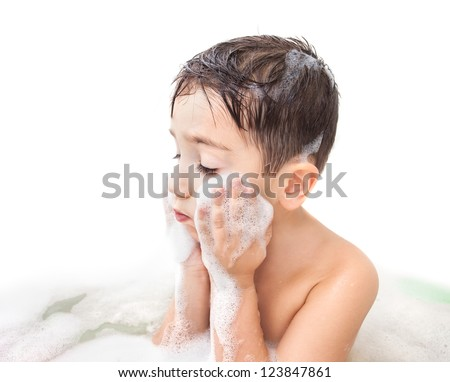 Little boy washing face in the bathroom - stock photo