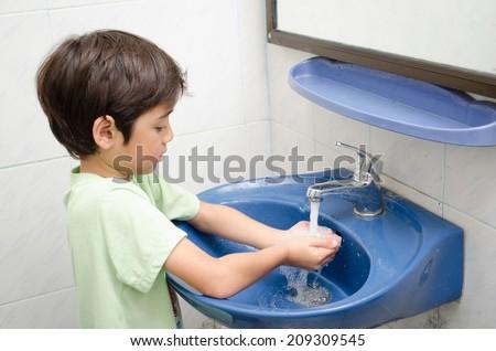 Little boy washing hand - stock photo