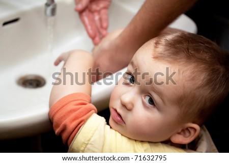 Little boy washing hands - stock photo