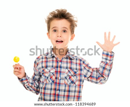 Little boy wave goodbye with lollipop in hand isolated on white - stock photo