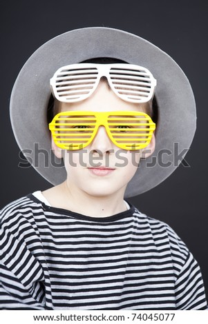 little boy wearing funny hat and silly glasses - stock photo