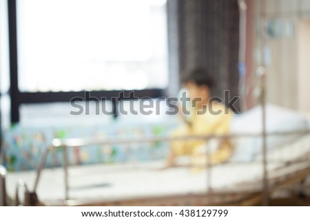 little boy wearing oxygen mask on face in hospital ward, blur, Sitting on the bed patients. - stock photo