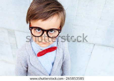little boy wearing vintage glasses - stock photo