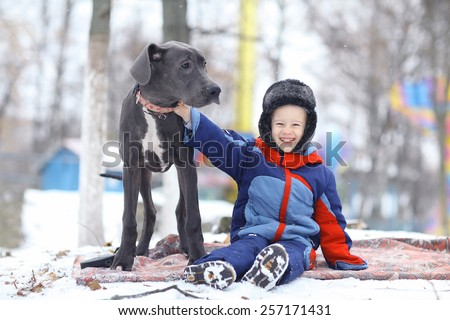 little boy with a big black dog breed - stock photo