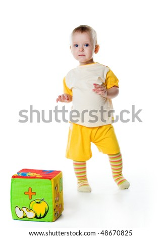 Little boy with a big block on white background - stock photo