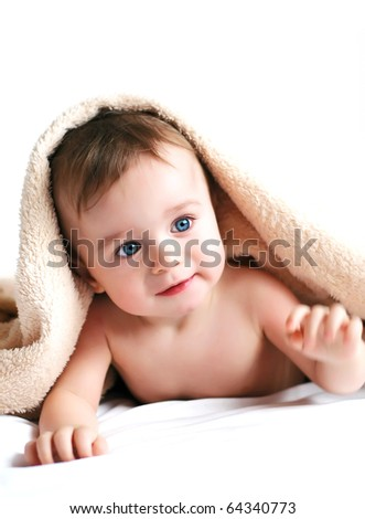 Little boy with a blanket on head