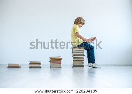 Little boy with a books - stock photo