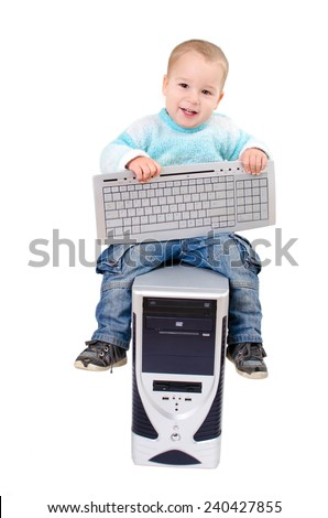 little boy with a computer - stock photo