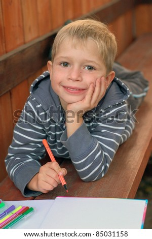 little boy with a marker pen - stock photo