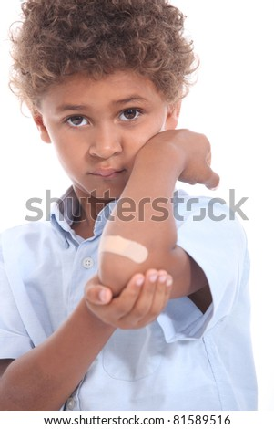 Little boy with a plaster on his arm - stock photo