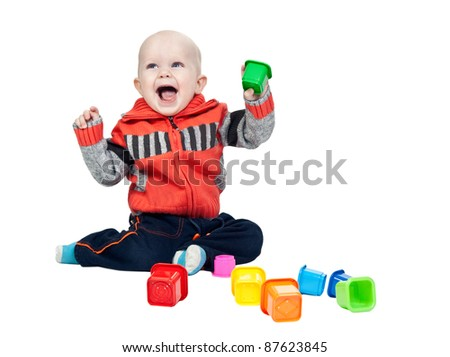 little boy with a plastic pyramid in the studio on a white background - stock photo