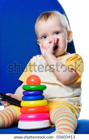 Little boy with a pyramid on the chair. White background - stock photo