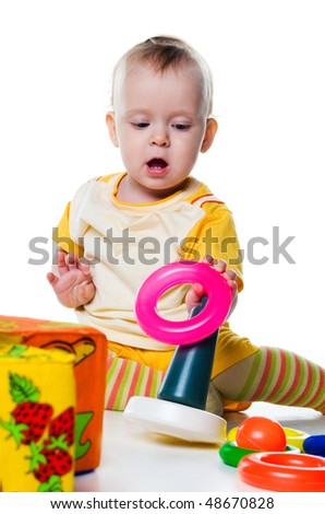 Little boy with a pyramid on white background - stock photo
