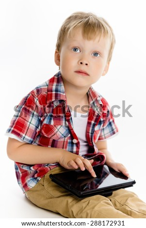 Little boy with a Tablet PC. studio