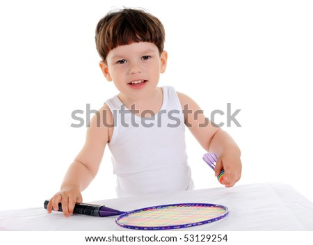 little boy with a tennis racket on a white background - stock photo