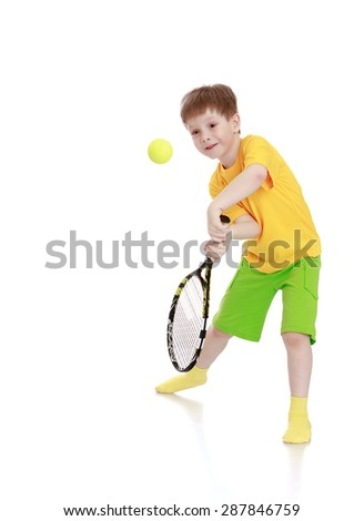 little boy with a tennis racket while hitting the ball-isolated on white background - stock photo