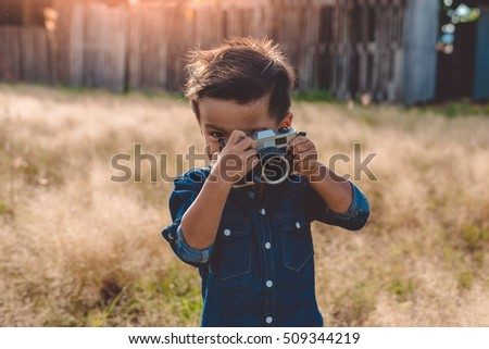 Little boy with a vintage camera,photographer boy
