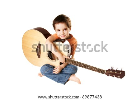 Little boy with acoustic guitar isolated on white background - stock photo