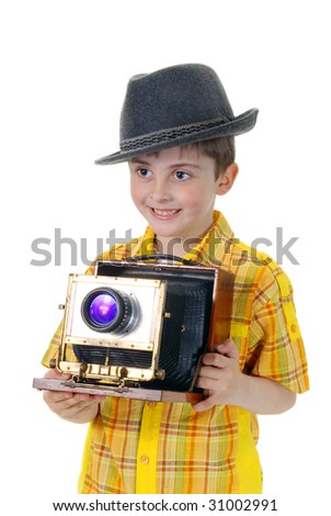 Little boy with an old camera on a white background - stock photo