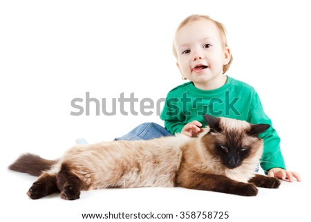 little boy with balinese cat isolated on white