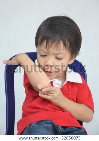 Little boy with bandage - stock photo