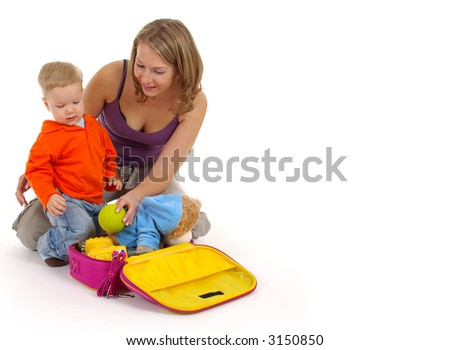 Little boy with beautiful mom on white background packing bags.