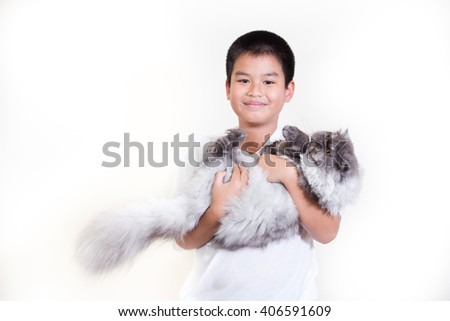 Little boy with beautiful Persian grey cat in hands