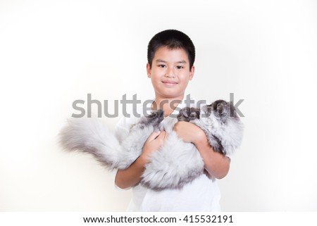 Little boy with beautiful Persian grey cat in hands - stock photo