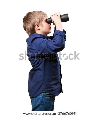 little boy with binoculars - stock photo