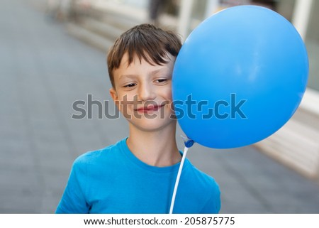 Little boy with blue air balloon, outdoor portrait - stock photo