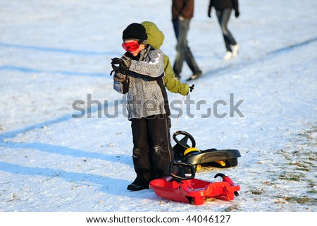 little boy with bobsled - stock photo