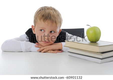 Little boy with book. Isolated on white background - stock photo