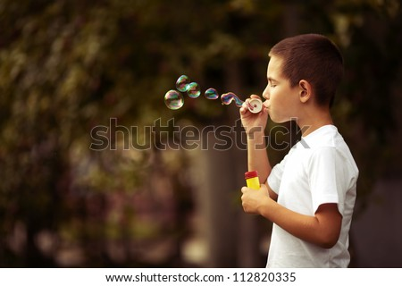 little boy with bubbles - stock photo