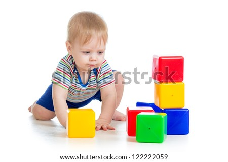 little boy with building blocks - stock photo