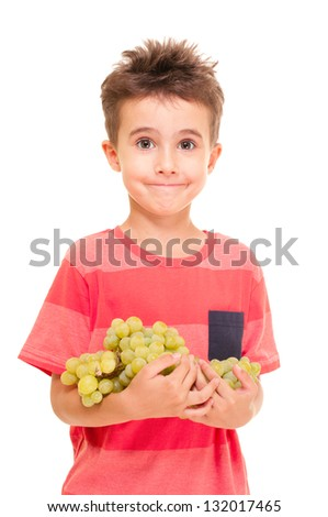 Little boy with bunch of grapes isolated on white - stock photo