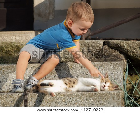 Little boy with cat - stock photo