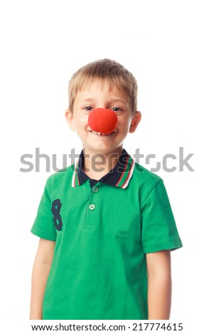 Little boy with clown nose isolated on white background - stock photo