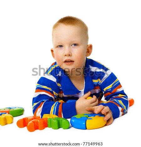 Little boy with color toys on white - stock photo