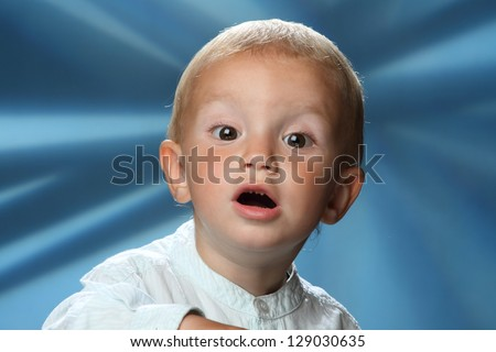 little boy with emotions surprise - stock photo