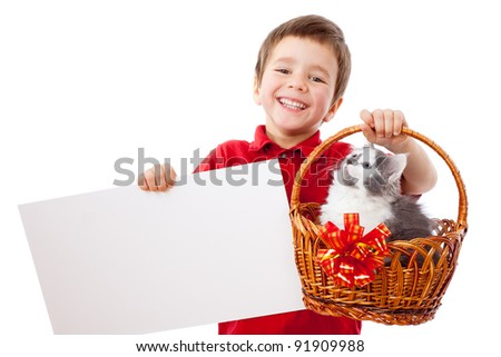Little boy with empty banner and kitty in wicker, isolated on white