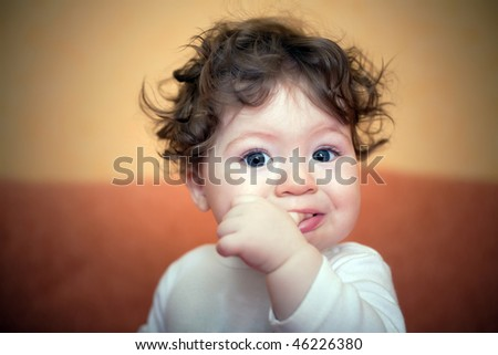 little boy with finger in mouth - stock photo