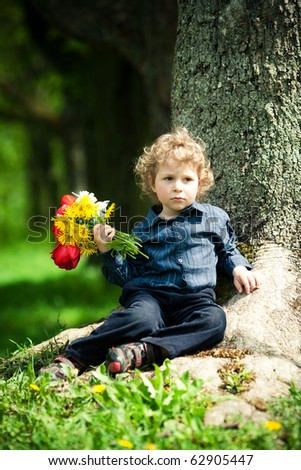 little boy with flowers - stock photo