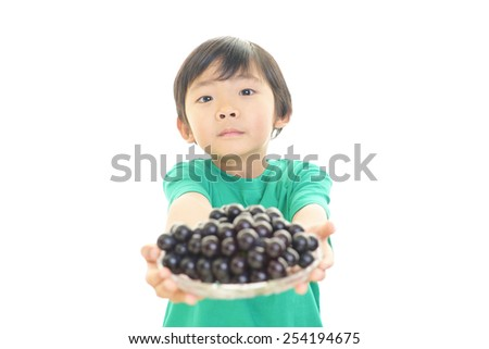 LIttle boy with fruits