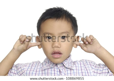 Little boy with funny face, pulling himself on the ears,