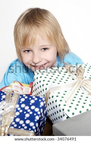 little boy with gifts on a light background