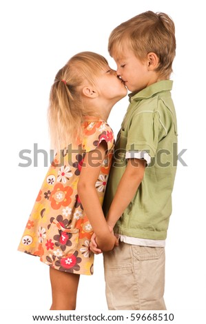 Little boy with girl isolated on white background. Friendly kiss. - stock photo