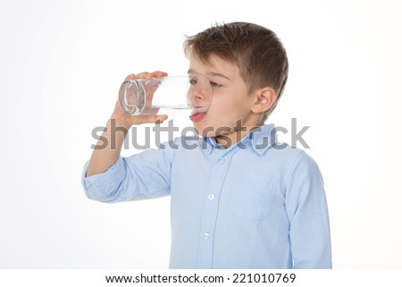 little boy with glass of water - stock photo