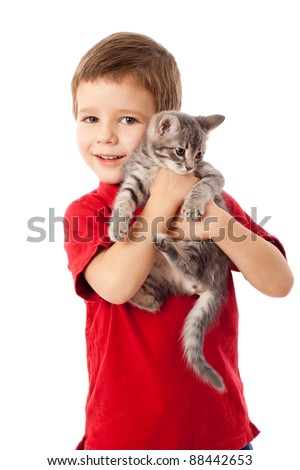 Little boy with gray kitty in hands, isolated on white