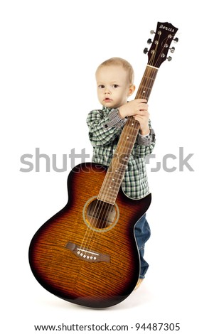 little boy with guitar - stock photo