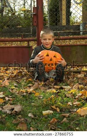 Little boy with halloween pumpkin - stock photo